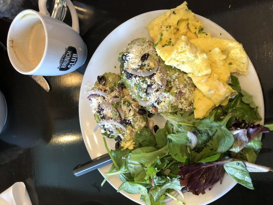 The Toastest with the Mostest with scrambled eggs and mixed greens from Bassett Street Brunch Club.