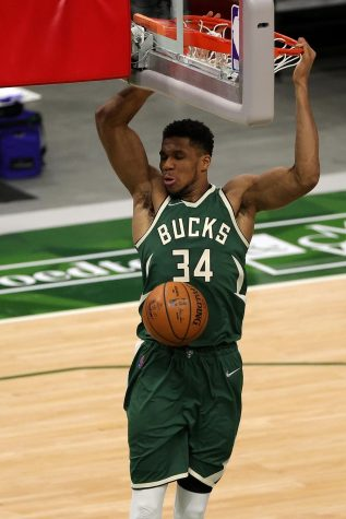 The Milwaukee Bucks' Giannis Antetokounmpo dunks against the New York Knicks during the second half at Fiserv Forum in Milwaukee on March 11.