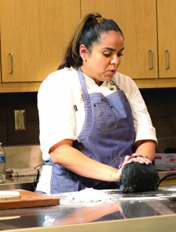Carolina Diaz, chef at Terzo Piano in Chicago, creating a dish at the Chef series event.