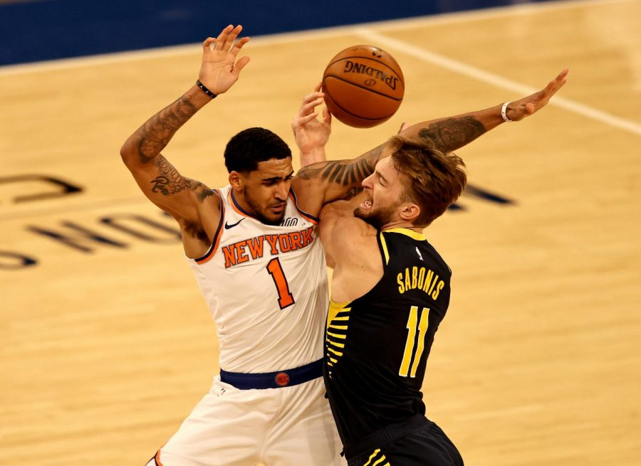 The Indiana Pacers' Domantas Sabonis (11) tries to take a shot as the New York Knicks' Obi Toppin (1) is called for a foul in the second quarter at Madison Square Garden in New York on Feb. 27.