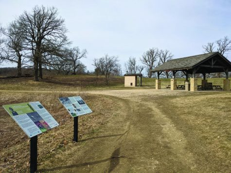 Park shelter and information signs at Donald County Park.