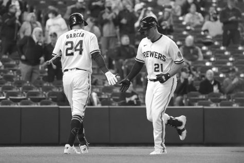 The Milwaukee Brewers' Travis Shaw (21) is congratulated by teammate Avisail Garcia (24) following a third-inning solo home run against the Chicago Cubs at American Family Field on Wednesday, April 14, in Milwaukee. The Brewers are now second in the NL Central