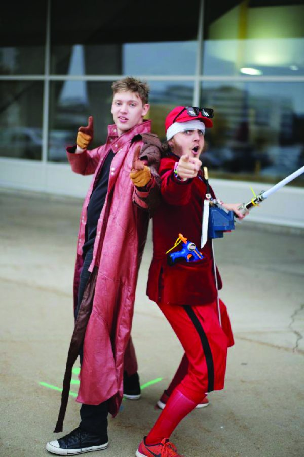 Above, Alan Zarzycki (left) along with a friend as they cosplay characters. Below, a film club meeting held over video chat.