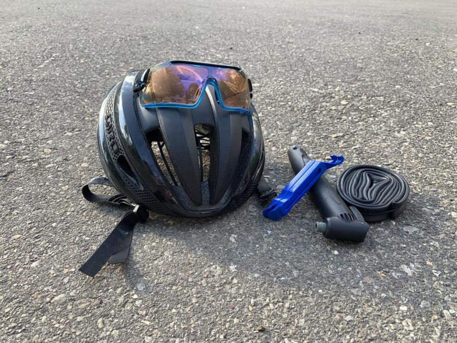 A helmet, glasses, multitool, CO2 inflator and inner tube can help ensure a safe bike ride.