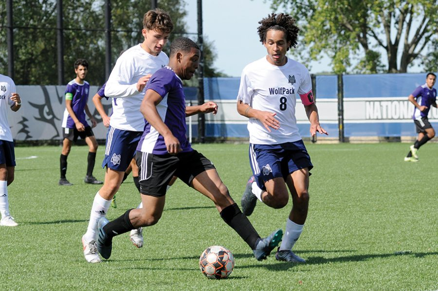 Madison College's Jonas Luskey Sanders, right, scored three goals against Joliet Junior College in his team's 6-0 victory on Sept. 25.