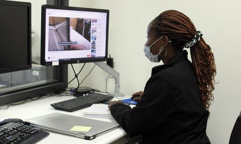 A volunteer works in the re-opened WolfPack Techies office at the Truax Campus.