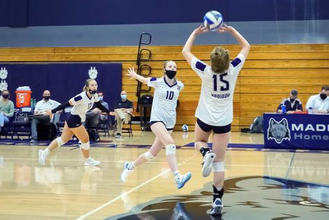 Madison College's Kaleia Lawrence, right, sets middle blocker Calla Borchert on Oct. 5.